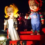 Throw me something, Chucky! The doll and his bride make a creepy entrance at the  annual parade.