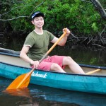 Igor Pak (LLM '15) ventures on an environmental law canoe trip on Wolf River led by Prof. Oliver Houck.