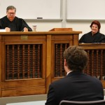 Moot court judges Roland Belsome (L '84) (an appellate judge) and Kathryn Hill (a prosecutor) give students feedback.