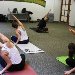 Namaste: Prof. Keith Werhan leads students in stress-relieving yoga sessions before exams.