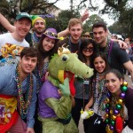 International students Enrique Rubio, Dennis Westerink, Nathan Sarkas, Dennis Zhao, Justus Langelittig, Claudia Juárez and Iliana Ibarra catch the Krewe of Mid-City parade at Mardi Gras.