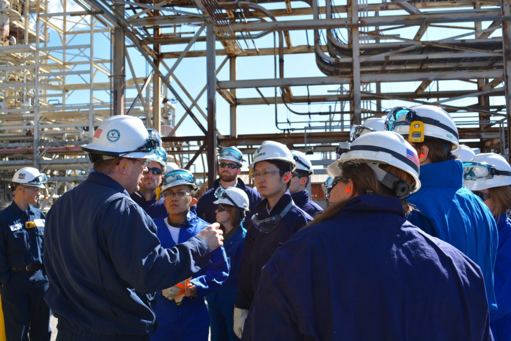 Andre Marquette, environmental engineering manager at Valero's St. Charles refinery, explains how the crude unit works before students step inside.
