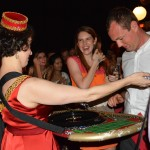 Prof. Pamela Metzger deals roulette to Janelle Sharer (L '16) and Andrew Cox (L '17) at the Public Interest Law Foundation's Casino Royale-themed auction fundraiser.