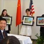 Shiwan Cui (LLM '15) displays her watercolor paintings of Tulane's campus for visiting Chinese judges.