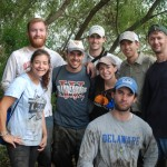 Tulane Environmental and Energy Law Society students celebrate a successful day planting trees to protect wetlands in partnership with the Coalition to Restore Coastal Louisiana.