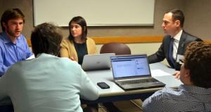 Brian Rosenblatt (L '08) helps transactional students negotiate to close a deal.