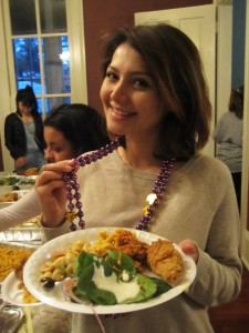 Sharaf Asgarova (LLM '15) samples Creole cuisine at Professor Herb Larson's Muses dinner. Photo by Rubaiyat Rahman.