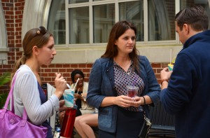 Assistant Dean of Students Abigail Gaunt (center) chats with students over New Orleans-style snowballs at an event promoting Tulane's health and wellness services.